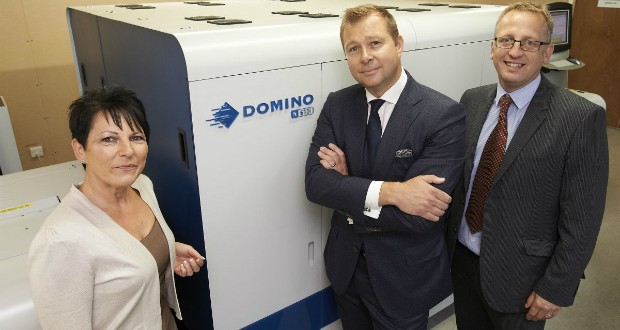 From left: Michaela Smith, business manager, Charapak Labels, Richard Smith, owner and managing director, Charapak and Stephen Hancock, UK sales manager - Digital Colour, Domino in front of N610i digital ink jet label press