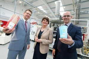 Outgoing CEO Jarek Zasadzinski, left with First Minister Arlene Foster and incoming CEO Philip Woolsey at opening the new Dungannon manufacturing hall